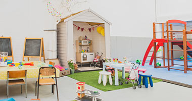 Play area with play kitchen